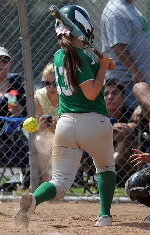 . Monrovia\'s Brooke Mann hit by a pitch in the fourth inning of the Northview Tournament championship softball game against Covina at Northview High School on Thursday, April 4, 2013 in Covina, Calif.  Monrovia won 6-0. 