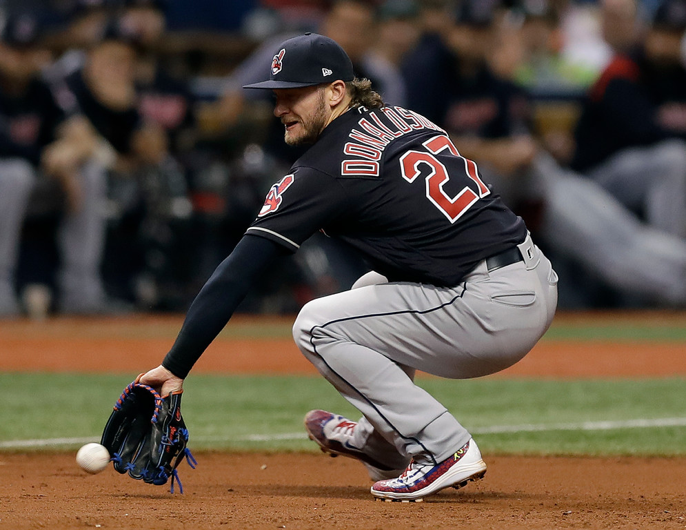 . Cleveland Indians third baseman Josh Donaldson fields a ground ball by Tampa Bay Rays\' C.J. Cron during the sixth inning of a baseball game, Tuesday, Sept. 11, 2018, in St. Petersburg, Fla. (AP Photo/Chris O\'Meara)