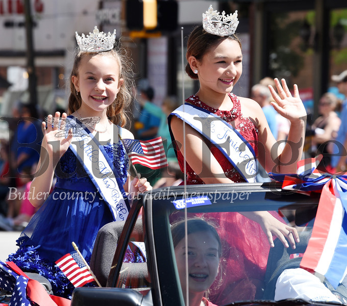 Harold Aughton/Butler Eagle: Samantha Capriotti, 2019 Little Miss Butler County (on left) and Rylee Werner 2019 Junior Miss Butler County wave to the crowd gathered Monday morning to watch the Butler Memorial Day Parade.