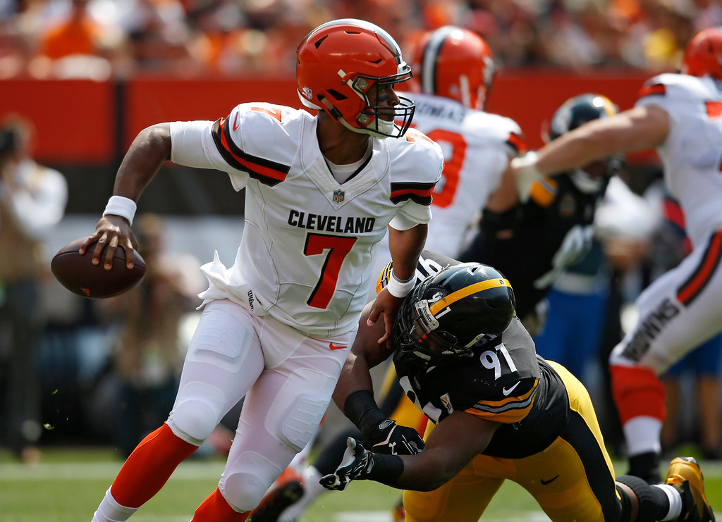 . Cleveland Browns quarterback DeShone Kizer (7) avoids Pittsburgh Steelers defensive end Stephon Tuitt (91) during the first half of an NFL football game, Sunday, Sept. 10, 2017, in Cleveland. (AP Photo/Ron Schwane)