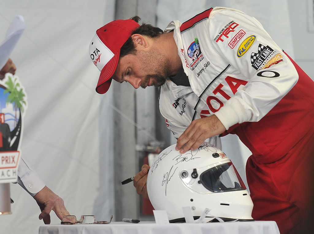 . 4/9/13 - Jeremy Sisto autographs a helmet for auction, during media day for the 39th Annual Toyota Grand Prix of Long Beach. The celebrity/pro races spent the day practicing on the track, joking with their racing partners and giving interviews. Photo by Brittany Murray / Staff Photographer