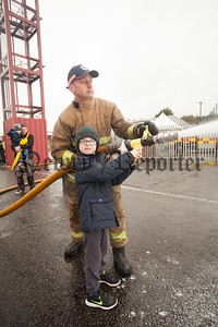 Tyler Clark with Firefighter Seamus McLoughlin. R1606013
