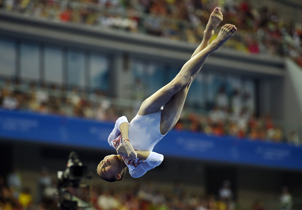 . China\'s Shang Chunsong performs on the beam during the women\'s qualification round at the Gymnastics World Championships in Nanning, in China\'s southern Guangxi province on October 6, 2014. GREG BAKER/AFP/Getty Images