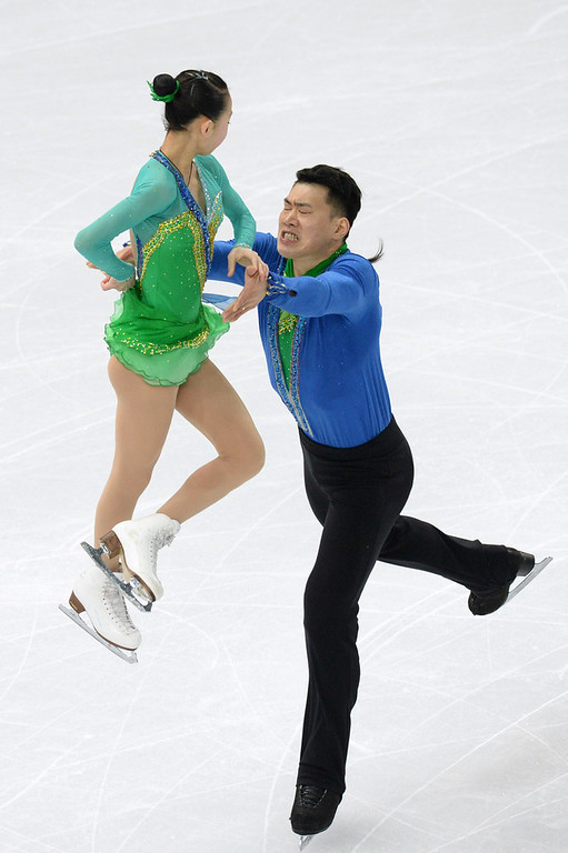. China\'s Zhang Hao and China\'s Peng Cheng perform during the Figure Skating Pairs Team Short Program at the Iceberg Skating Palace during the Sochi Winter Olympics on February 6, 2014.  (YURI KADOBNOV/AFP/Getty Images)