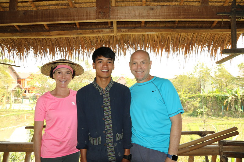With our amazing guide, Den at The Living Land Rice Farm - Luang Prabang, Laos