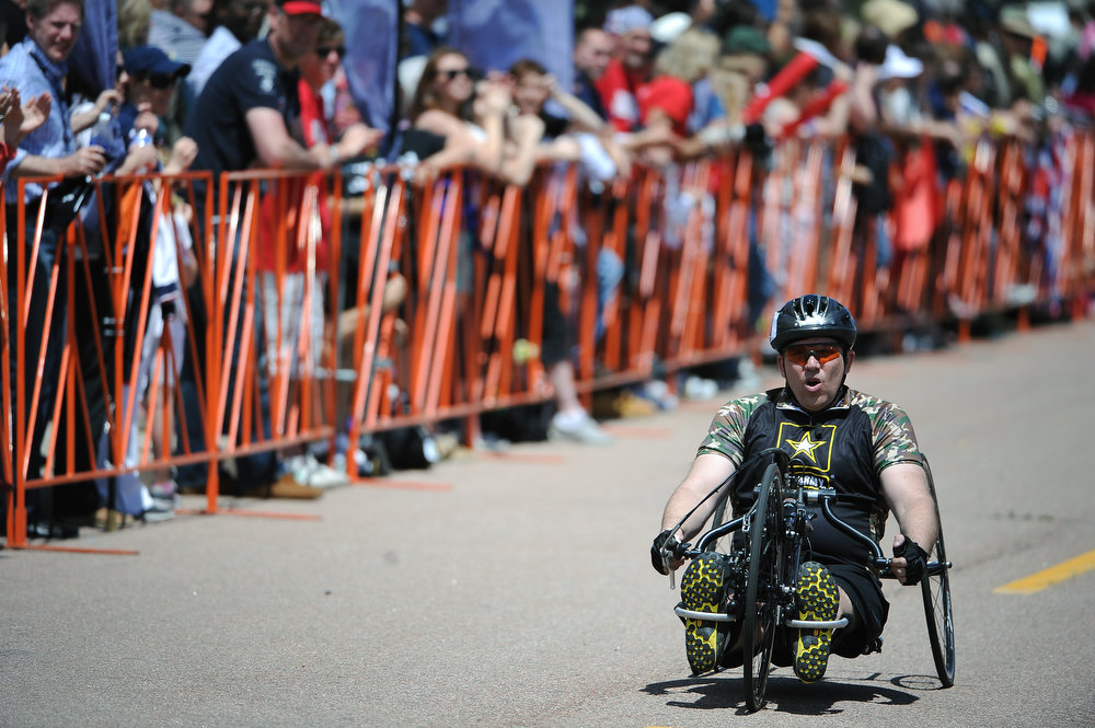 . Danny Dudek, with the Army, makes his way towards the finish line of the Men\'s 10K Handcycle race. The fourth annual Warrior Games cycling event took started and finished at Falcon Stadium on the grounds of the Air Force Academy in Colorado Springs, CO on May 12, 2013.  HRH Prince Harry was on hand to start the race as well as to hand out medals at the finish line.   A total of 260 wounded, ill and injured service members and veterans came to compete in the week long games.  Members of the Army, Marine Corps, Navy/Coast Guard/Air Force. Special Operations and the British Armed Forces all took part in the competition.  Other events included in the Warrior Games are shooting, sitting volleyball, track & field and wheelchair basketball.  (Photo by Helen H. Richardson/The Denver Post)