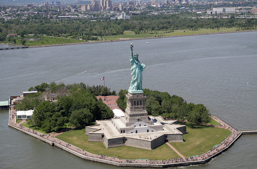 . An ariel view of the Statue of Liberty in New York Harbor, Friday, June 20, 2014.  (AP Photo/Seth Wenig)