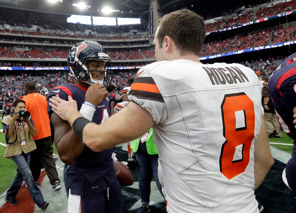 . Houston Texans\' Deshaun Watson (4) and Cleveland Browns\' Kevin Hogan (8) meet at midfield after their NFL football game, Sunday, Oct. 15, 2017, in Houston. (AP Photo/Eric Gay)