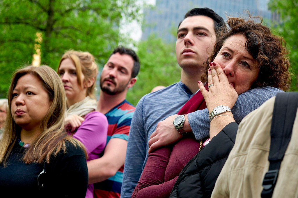 . Visitors watch a screen projection of the dedication ceremony for the National September 11 Memorial Museum in New York, Thursday, May 15, 2014.  (AP Photo/New York Daily News, James Keivom, Pool)