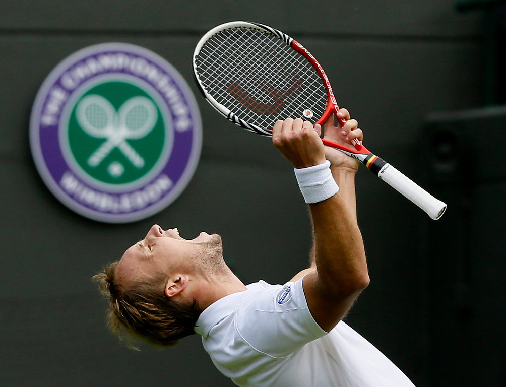. Steve Darcis of Belgium reacts as he defeats Rafael Nadal of Spain in their Men\'s first round singles match at the All England Lawn Tennis Championships in Wimbledon, London, Monday, June 24, 2013. (AP Photo/Kirsty Wigglesworth)