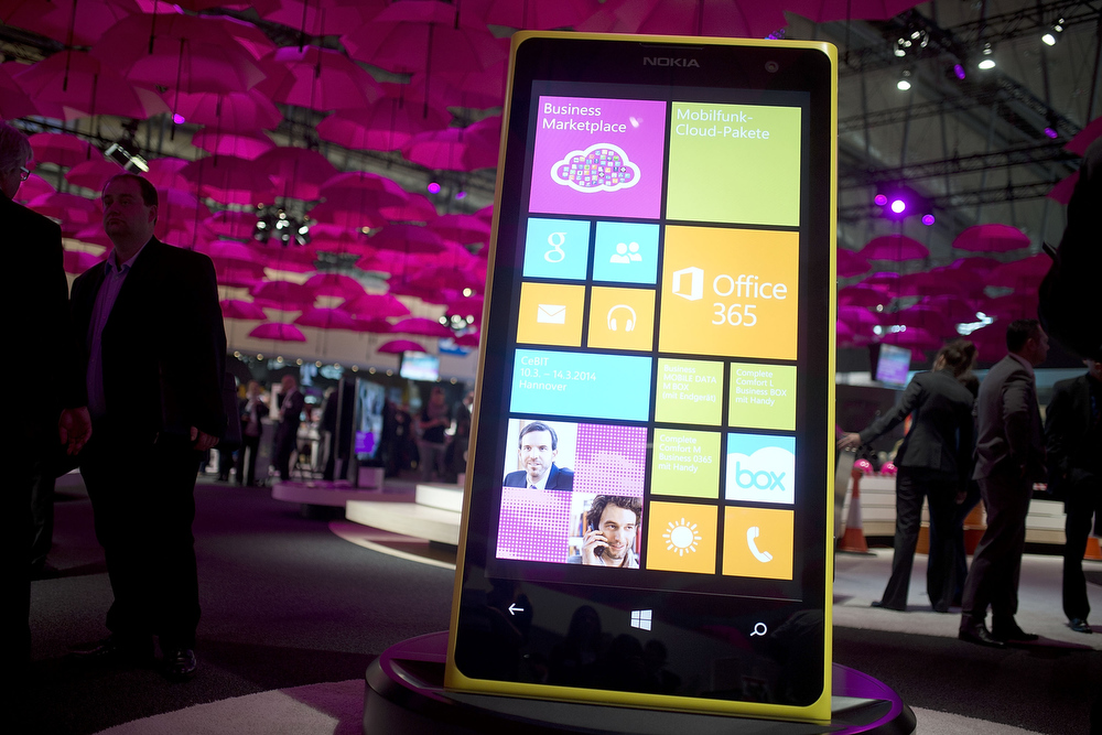 Description of . An oversized windows phone is seen at the Telekom stand at the 2014 CeBIT technology Trade fair on March 10, 2014 in Hanover, Germany. CeBIT is the world's largest technology fair and this year's partner nation is Great Britain.  (Photo by Nigel Treblin/Getty Images)
