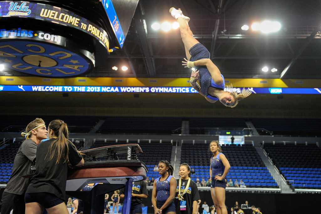 . UCLA\'s Kaelie Baer practices practices a leap off the vault, Thursday, April 18, 2013, for the upcoming NCAA Women\'s Gymnastics Championships at Pauley Pavilion. (Michael Owen Baker/Staff Photographer)