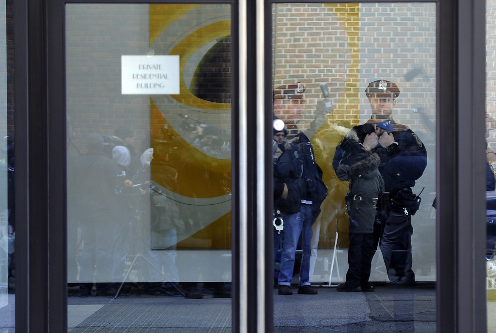 ". New York City Police are reflected in the door of the apartment building of fashion designer L\'Wren Scott, the girlfriend of Rolling Stones frontman Mick Jagger, after she was found dead at her apartment in New York on March 17, 2014. A spokesman said Jagger, 70, was ""completely shocked and devastated\"" by the death of the 49-year-old Scott. US media reported that the former model was found hanged. Jagger is currently in Australia, where he is touring with the Stones, who were due to perform in Perth on Wednesday. Scott had dated the Rolling Stones frontman since 2001 following his split from wife Jerry Hall.          (TIMOTHY A. CLARY/AFP/Getty Images)"