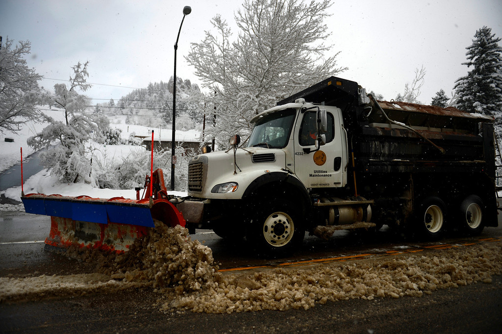 . BOULDER, CO. - APRIL 23: A snowplow clearing snow and ice off of Cayon Road in Boulder April 23, 2013 Boulder, Colorado. (Photo By Joe Amon/The Denver Post)