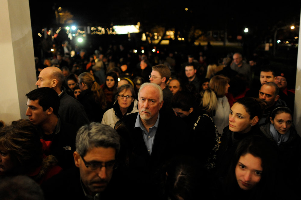. Mourners gather at the St. Rose of Lima Roman Catholic Church at a vigil service for victims of the Sandy Hook School shooting December 14, 2012 in Newtown, Connecticut. Twenty-seven people are dead, including 20 children, after a gunman identified as Adam Lanza in news reports opened fire in the school. Lanza also reportedly died at the scene.  (Photo by Andrew Gombert-Pool/Getty Images)