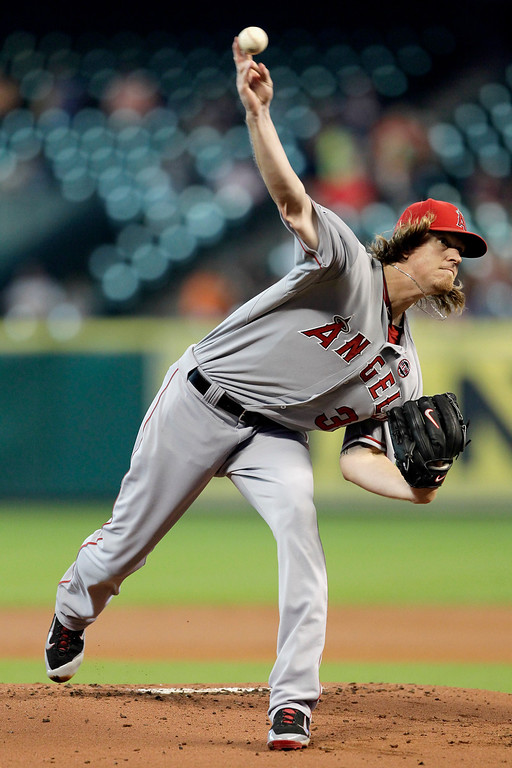 . HOUSTON, TX - SEPTEMBER 14:  Jered Weaver #36 of the Los Angeles Angels of Anaheim throws in the first inning against the Houston Astros at Minute Maid Park on September 14, 2013 in Houston, Texas.  (Photo by Bob Levey/Getty Images)