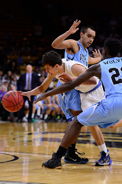 . David Simental (11) of Pueblo West tries to break through the defense of Breon Michel (23) and Noah Beatty (5) of Vista Ridge during the third quarterat the Coors Events Center on March 11, 2016 in Boulder, Colorado. Pueblo West defeated Vista Ridge 65-54 to advance to the 4A finals of Colorado state basketball tournament.  (Photo by Brent Lewis/The Denver Post)