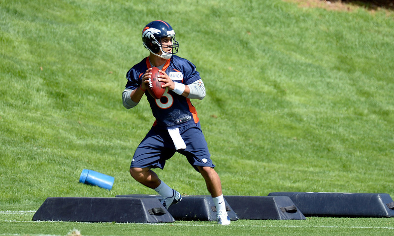 . Ryan Katz (8) of the Denver Broncos runs through drills during the teams OTAs May 20, 2013 at Dove Valley. All offseason training activities (OTAs) are voluntary until the mandatory minicamp June 11-13. (Photo By John Leyba/The Denver Post)