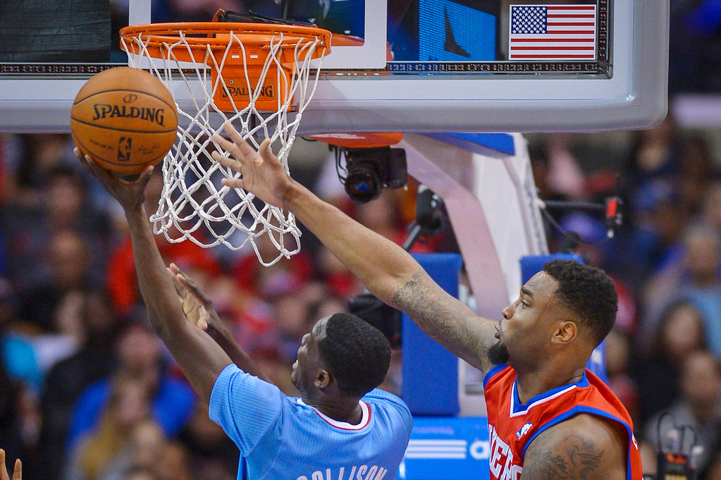 . Clippers� Darren Collison puts up two points as 76ers�Arnett Moultrie defends on the play at Staples Center Sunday.  The Clippers defeated the 76ers 124-78.  ( Photo by David Crane/Los Angeles Daily News )