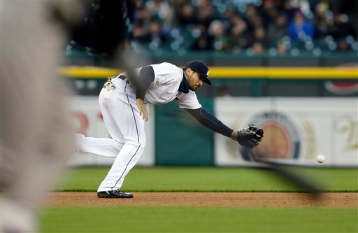 . Detroit Tigers third baseman Nick Castellanos is unable to reach the single hit by New York Yankees\' Chris Young during the fourth inning of a baseball game, Tuesday, April 21, 2015, in Detroit. (AP Photo/Carlos Osorio)