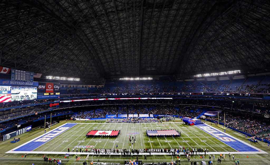 . The national anthems of the United States and Canada are played before the Buffalo Bills against the Atlanta Falcons in an NFL football game at Rogers Centre in Toronto, Sunday, Dec. 1, 2013. (AP Photo/The Canadian Press, Mark Blinch)