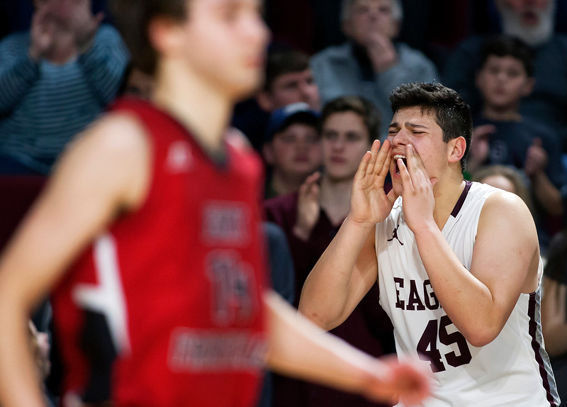 BANGOR, Maine -- 02/25/2017 -- George Stevens Academy's Stefan Simmons cheers on his team while they face Fort Fairfield during their Class C boys basketball championship game at the Cross Insurance Center in Bangor Saturday. Ashley L. Conti   BDN