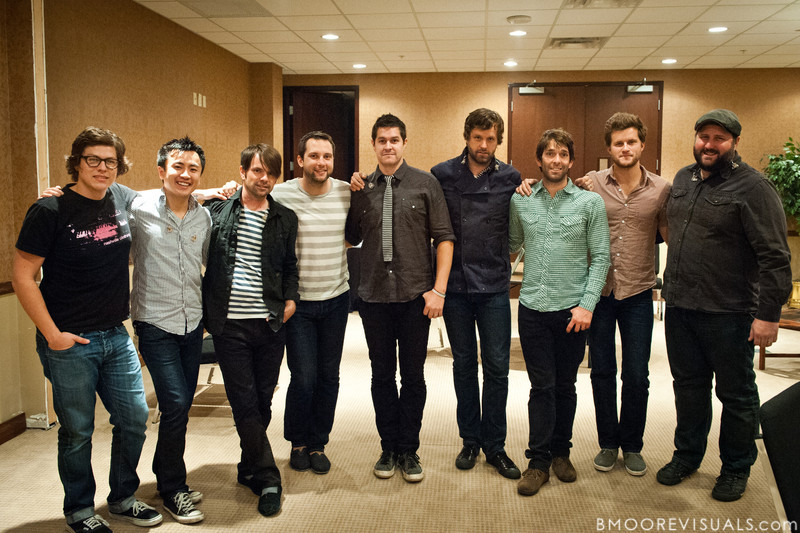 Joe Moralez, Hai Phung, Charlie Lowell, Brandon Heath, Dan Haseltine, Matt Odmark, Stephen Mason, Jake Goss, and Gabe Ruschival get together for a photo before Jars of Clay perform on October 23, 2010 at Countryside Christian Center in Clearwater, Florida