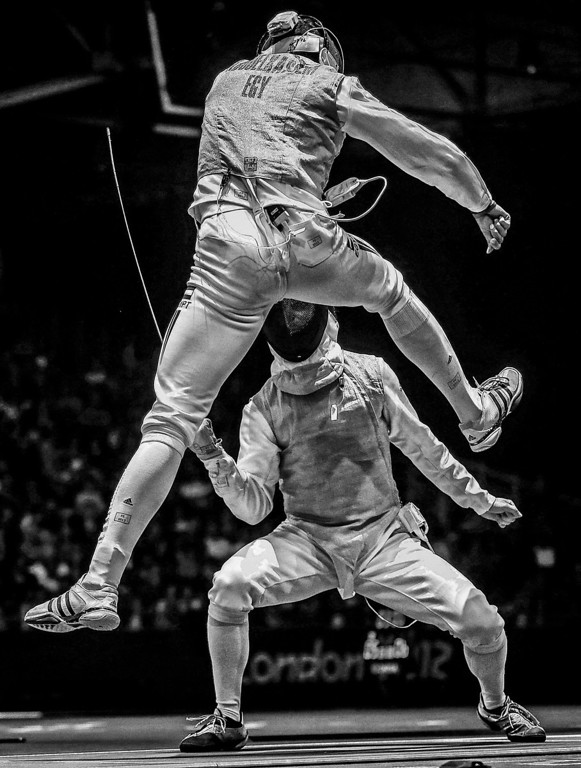 """. Sergei Ilnitsky of Russia, a photographer working for the European Pressphoto Agency, has won the second prize in the Sports Action Stories category of the World Press Photo Contest 2013 with the series \""""The Golden Touch - Fencing at the Olympics\"""". The picture shows Alaaeldin Abouelkassem of Egypt (top) in action against Peter Joppich of Germany during their Men\'s Foil Individual Round 16 at the London 2012 Olympic Games in London, taken on July 31, 2012 and distributed by the World Press Photo Foundation February 15, 2013.   REUTERS/Sergei Ilnitsky/European Pressphoto Agency/World Press Photo/Handout"""