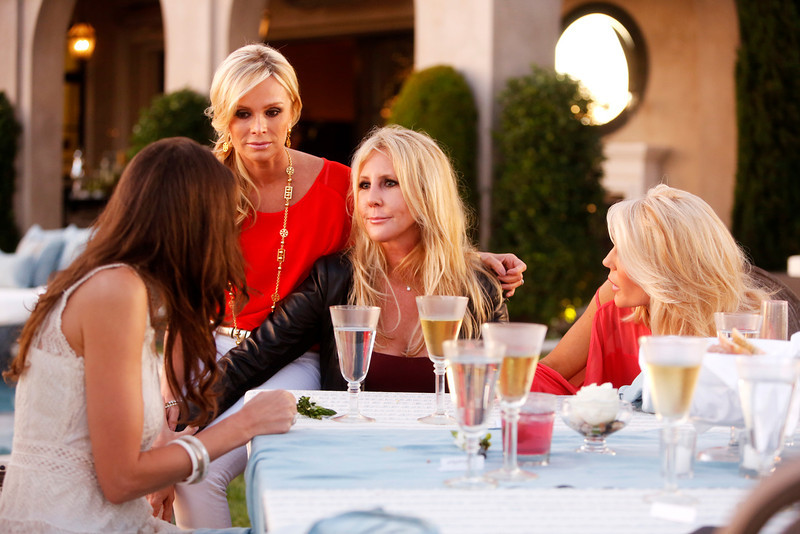 """. REAL HOUSEWIVES OF ORANGE COUNTY -- \""""All Housewives Clam Bake at Rachel\'s\"""" -- Pictured: (l-r) Heather Dubrow, Tamra Barney, Vicki Gunvalson, Gretchen Rossi -- (Photo by Vivian Zink/Bravo)"""