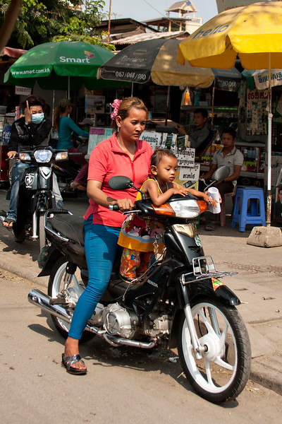 Children on motorcycles are not uncommon throughout Asia.