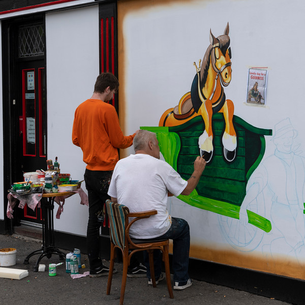 Artists painting a horse on a wall, Free Derry, Londonderry, Northern Ireland, United Kingdom