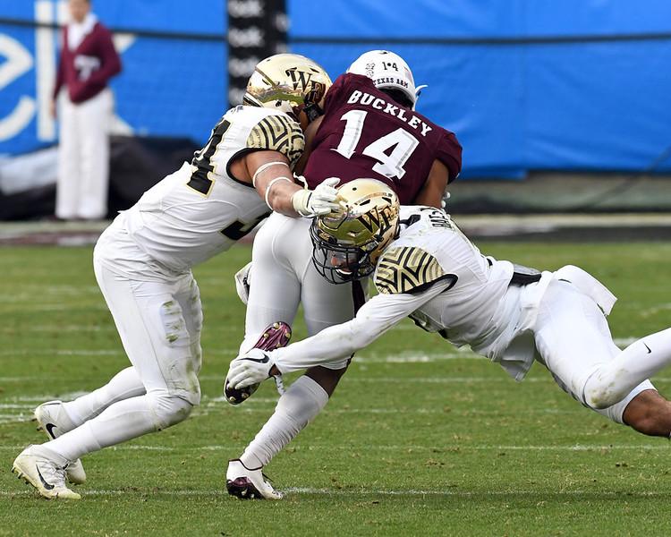 Jesse Bates and Demetrius Kemp tackle C Buckley.jpg