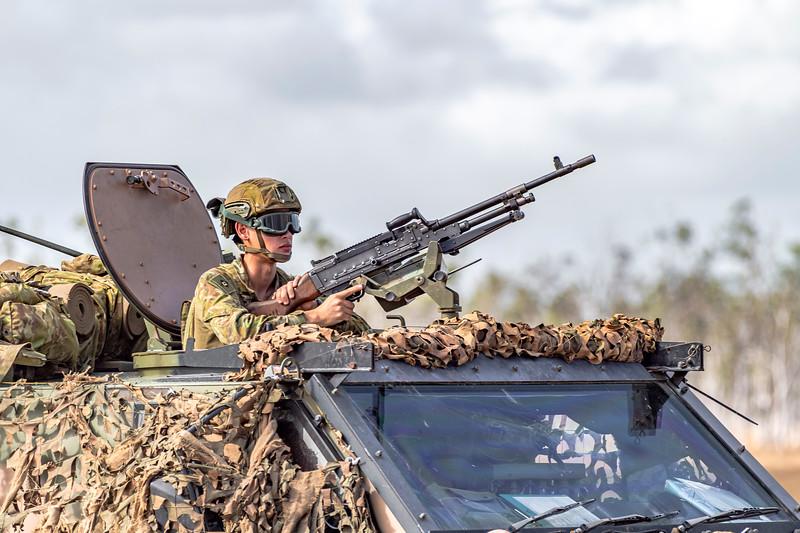 Exercise Talisman Saber 2019.  Soldier mans a light machine gun aboard a bushmaster during HiMARS live fire exercise.
