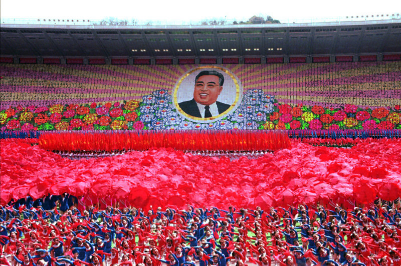 . Thousands of North Korean children dance and hold up colored cards to form a picture of Kim Il Sung at a rally in Pyongyang, North Korea, on Friday, April 28, 1995. For outsiders, the personality cults that North Korea has built around  late leader Kim Il Sung and his son and apparent heir, Kim Jong Il, are  almost unimaginable in their slavishness. But for North Koreans,  worshipping the Kims is as much a part of life as breathing. (AP Photo/John Leicester)