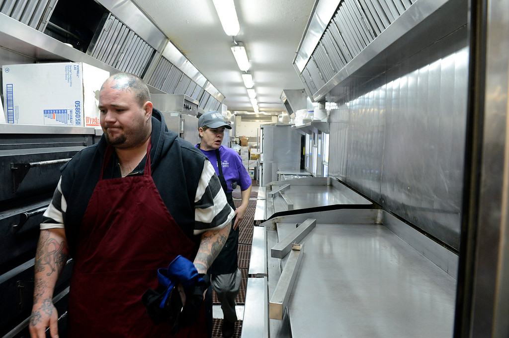 . Robert Molina assistant dinner cook and Jacki Gorrell lead breakfast cook do prep work in the mobile kitchen in the firefighters base camp for the Pfeiffer Ridge Fire in Pfeiffer Big Sur State Park on Friday December 20, 2013. (Photo David Royal/ Monterey County Herald)