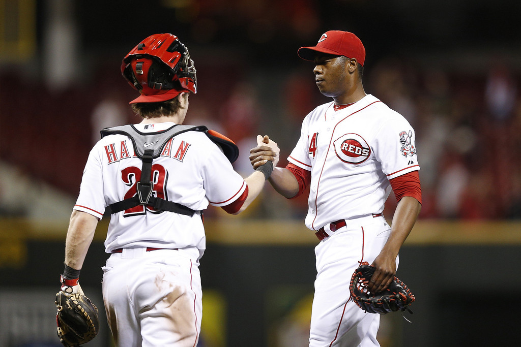 . Aroldis Chapman #54 and Ryan Hanigan #29 of the Cincinnati Reds celebrate after the game against the Colorado Rockies at Great American Ball Park on June 3, 2013 in Cincinnati, Ohio. The Reds won 3-0. (Photo by Joe Robbins/Getty Images)