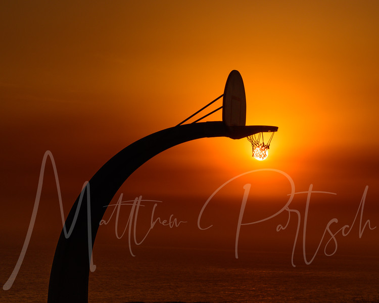 Sunset in Palos Verdes after Canyon 2 Fire in Anaheim Hills on October 9, 2017 with the sun through a basket ball net