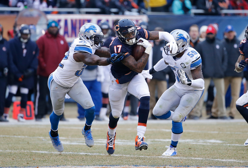 . Chicago Bears wide receiver Alshon Jeffery (17) carries the ball against Detroit Lions safety James Ihedigbo (32) and linebacker Tahir Whitehead (59) in the first half of an NFL football game Sunday, Dec. 21, 2014, in Chicago. (AP Photo/Charles Rex Arbogast)