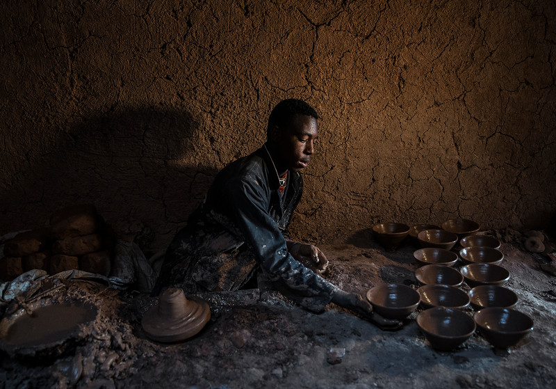 Potter at work in the town of Tamegroute, famous for its pottery.  Tamegroute, morocco, 2018