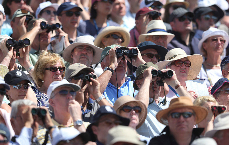 . Spectators watch Tiger Woods of the United States and Graeme McDowell of Northern Ireland on the 11th hole from a grandstand during the second round of the British Open Golf Championship at Muirfield, Scotland, Friday July 19, 2013. (AP Photo/Scott Heppell)