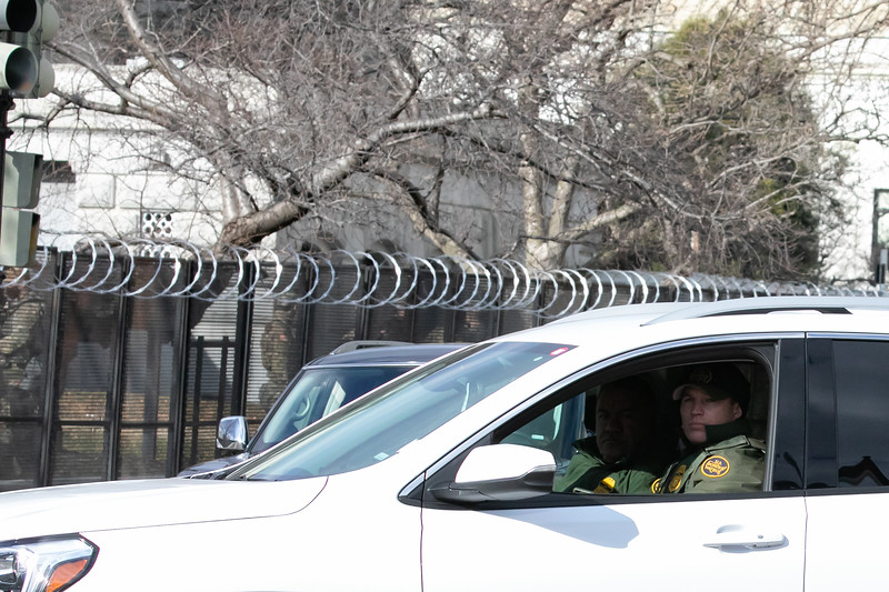 U.S. Border Patrol officers patrol a road near the U.S. Capitol during inauguration