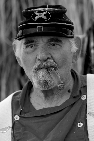 Reenactor Captain Art Sherry, at the age of 81, has been performing his duties for 15 years at Patriots Point, where a small group of Confederate reenactors set up camp, in Mt. Pleasant, South Carolina on Wednesday, April 13, 2011. ..The 150th Anniversary of the Firing on Ft. Sumter was commemorated with lectures, performances, demonstrations, and a living history throughout the area on James Island, Charleston, Mt. Pleasant, and Sullivan's Island during the week from April 8-14, 2011. Photo Copyright 2011 Jason Barnette