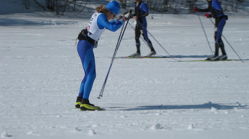 Women's 31K winner Tracy Hardin taking it to the finish line