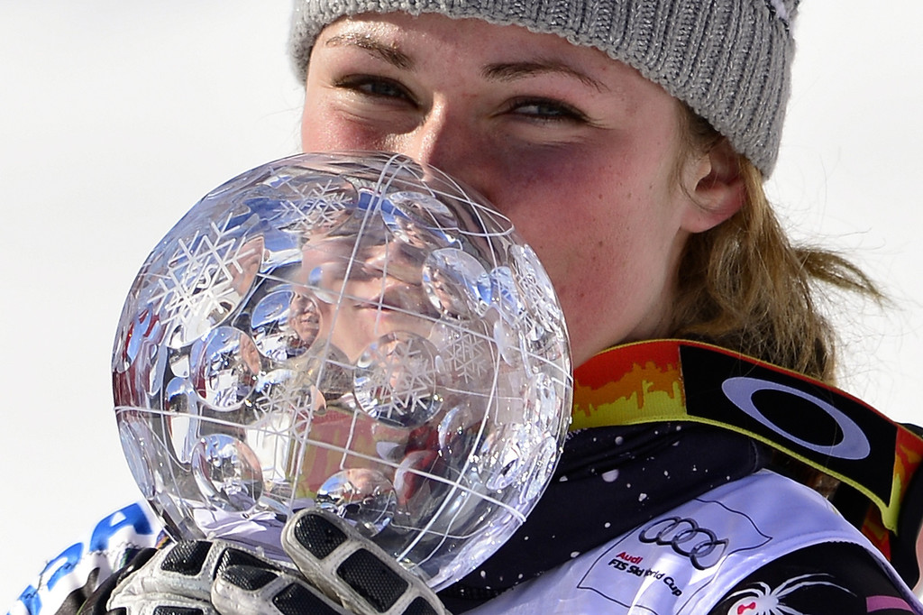 . Mikaela Shiffrin of the US celebrates after winning the Women Slalom race and the crystal Globe trophy at the Alpine ski World Cup finals on March 16, 2013 in Lenzerheide. AFP PHOTO / FABRICE COFFRINI/AFP/Getty Images