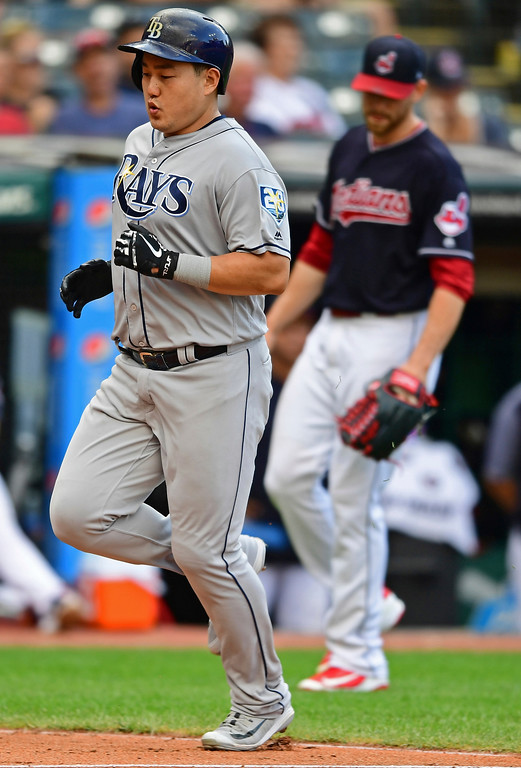 . Tampa Bay Rays\' Ji-Man Choi scores on a two-RBI double by Brandon Lowe in the seventh inning of a baseball game against the Cleveland Indians, Sunday, Sept. 2, 2018, in Cleveland. The Rays won 6-4. (AP Photo/David Dermer)