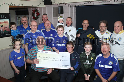 Newry Chelsea & Leeds UTD Supporters Clubs Annual Charity Football Match played in August present a Cheque for£950  to Newry Special Olympics AFC  which was accepted by Big O and Betty McGeoghegan, R1450401