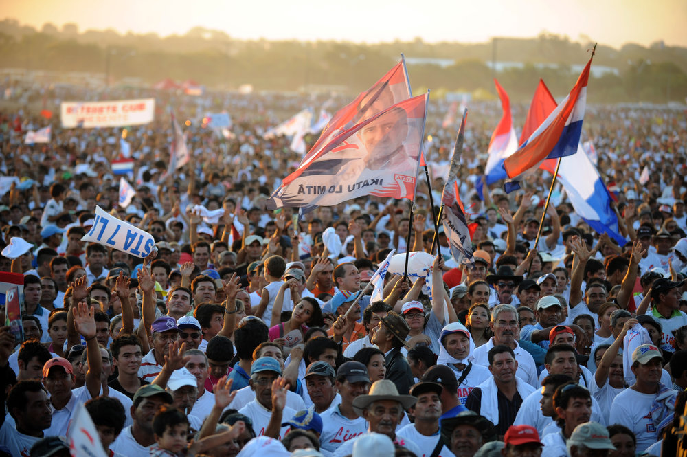 Description of . Supporters of Paraguayan presidential candidate for the National Union of Ethical Citizens (UNACE) party, Lino Oviedo, are seen during a rally for the initiation of his political campaign in Luque, Paraguay on, January 12 , 2013. Paraguay will hold presidential elections on April 21, 2013. NORBERTO DUARTE/AFP/Getty Images
