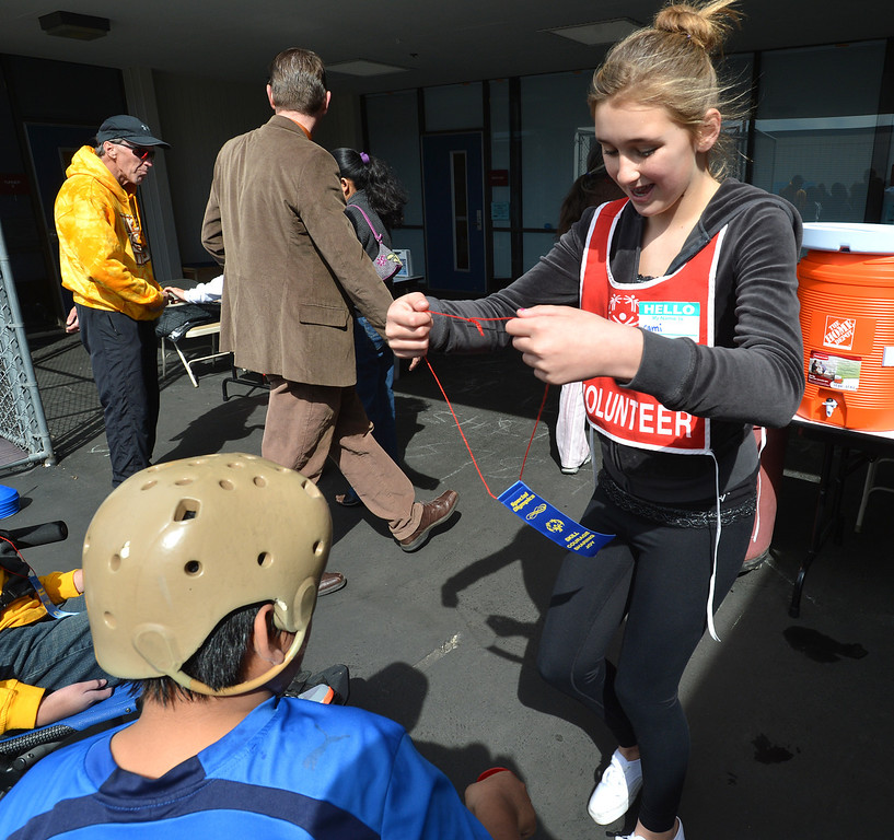 . Volunteer Cami Cox, 13, an eighth grader at Walnut Creek Intermediate School, prepares to hand out a ribbon to a Special Olympics participant during a Special Olympics basketball skills event at Turner Elementary School in Antioch, Calif., on Friday March 8, 2013.  (Dan Rosenstrauch/Staff)