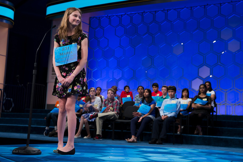 ". Maria Kaltchenko of Tupelo, Miss., smiles after spelling the word ""pointelle\"" correctly during the semifinal round of the National Spelling Bee, Thursday, May 29, 2014, in Oxon Hill, Md. (AP Photo/ Evan Vucci)"