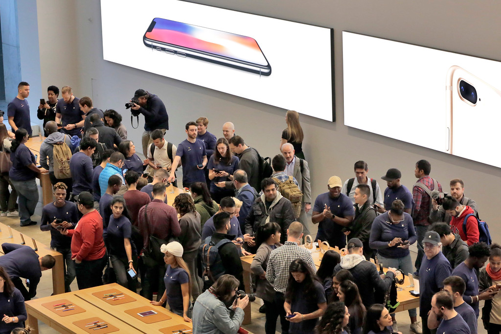 . Customers at the Apple Store on New York\'s Fifth Avenue wait to buy their iPhone X, Friday, Nov. 3, 2017. (AP Photo/Richard Drew)